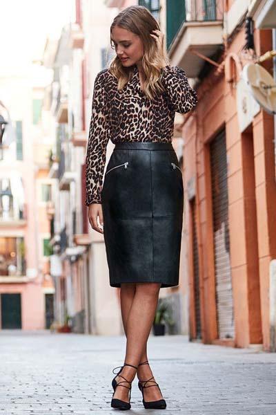 Μαύρη στενή δερμάτινη φούστα με φερμουάρ στις τσέπες και λεοπάρ μπλούζα