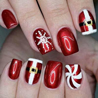 Εντυπωσιακά σχέδια σε κόκκινα νύχια για τα Χριστούγεννα