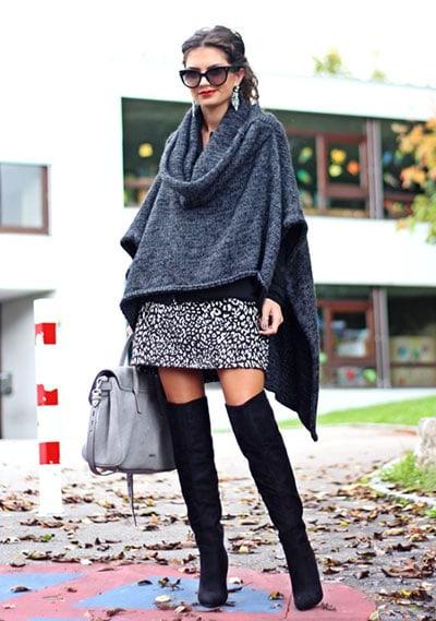 Μάλλινο ζεστό πόντσο με μίνι φούστα και μπότες over the knee
