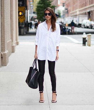 Δερμάτινο κολάν και μακρύ λευκό πουκάμισο για chic εμφανίσεις