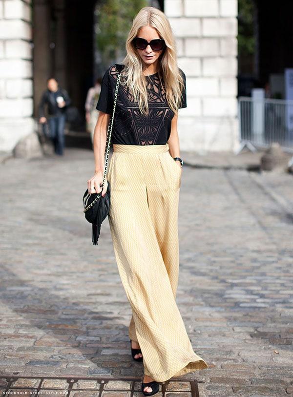 Βραδινό ντύσιμο με ψηλόμεση κίτρινη παντελόνα και μαύρη μπλούζα με διαφάνεια