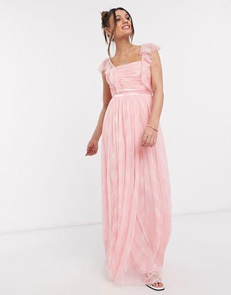 Μακρύ πλισέ ροζ φόρεμα με βολάν τιράντες