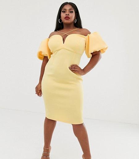 Κίτρινο μίντι εφαρμοστό φόρεμα για παχουλές με φουσκωτά μανίκια και έξω τους ώμους