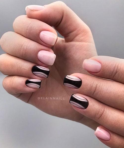 Γαλακτερό ροζ μανικιούρ με μαύρα σχέδια