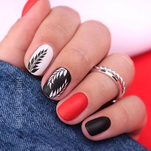 Κόκκινο μαύρο λευκό σχέδιο νυχιών