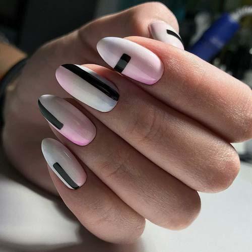 Άσπρα ροζ όμπρε νύχια με μαύρες γραμμές