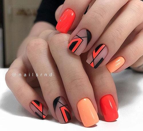 Γραμμικά summer nails σε πορτοκαλί και μαύρο χρώμα