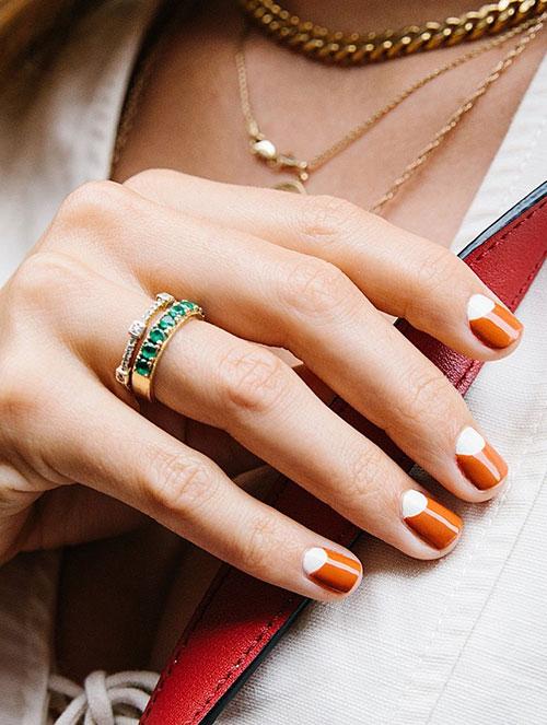 Πορτοκαλί νύχια με άσπρο ανάποδο γαλλικό