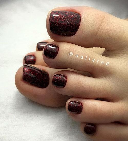 Μαύρο πεντικιούρ με κόκκινη χρυσόσκονη